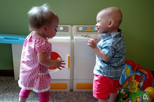 Two children playing in the nursery