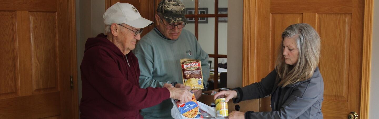 Volunteers packing bags of food
