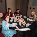 Youth around the table at Passover dinner reenactment