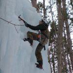 Boy climbing ice wall