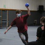 Teen boy playing dodgeball