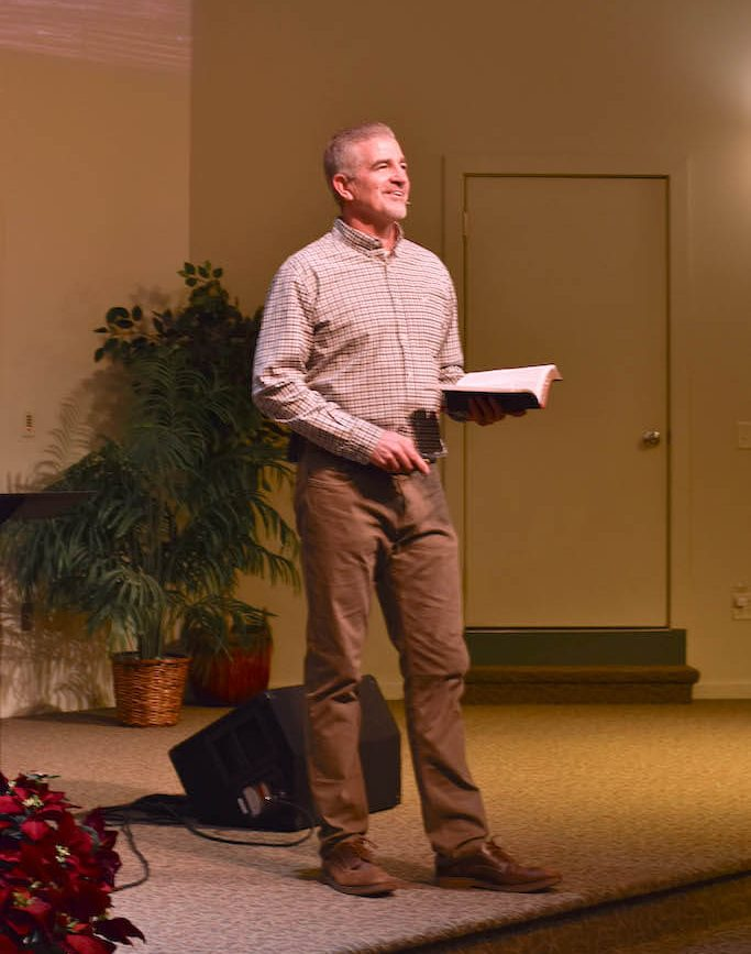 Pastor Bob Guilford speaking to congregation