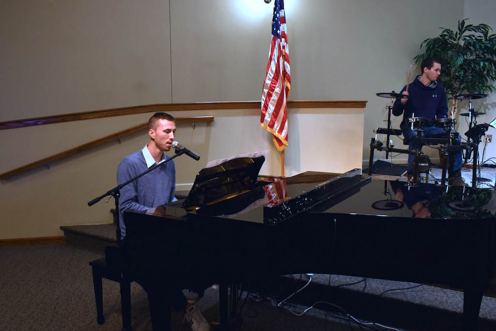 Members of the worship team on piano and drums